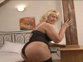 Top enormous granny enjoys a..