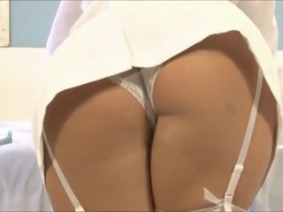 Sexy brunette nurse getting..